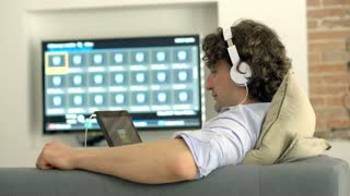 Man finish watching something on tablet and smiling to the camera