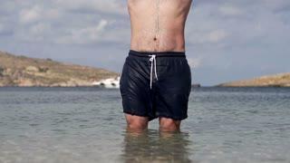 Man jumping into the sea, slow motion shot at 120fps