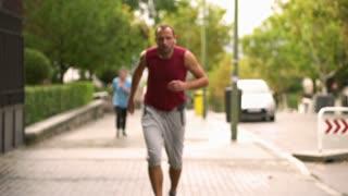 Man resting after running, slow motion shot at 240fps, steadycam shot