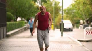 Man resting after running, slow motion shot, steadycam shot
