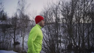 Man running alone on wintry day, steadycam shot, slow motion shot at 240fps