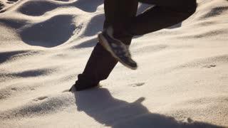 Man running up on deep snow, steadycam shot, slow motion shot at 240fps