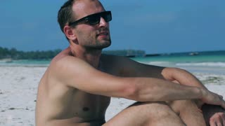Man sitting on the beach and relaxing