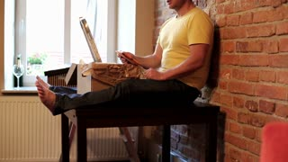 man sitting on the table with tablet and planning to decorate his new flat