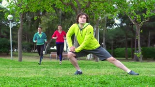 Man stretching legs before jogging, steadycam shot, slow motion shot at 240fps