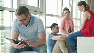 Man using tablet and doing serious look to the camera on the party