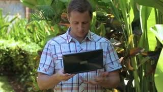 Man working on laptop in the garden