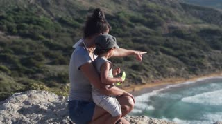 Mother with her son on cliff at the view point, slow motion shot at 120fps