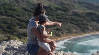 Mother with her son on cliff at the view point, slow motion shot at 240fps