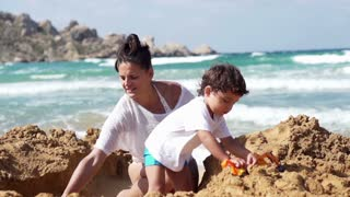 Mother with her son playing on the beach, slow motion shot at 240fps