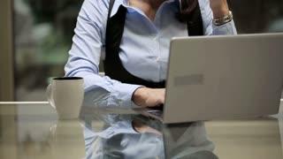 Overworked businesswoman have a headache in the office, steadycam shot.