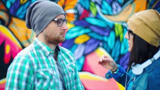 Pair of hipsters having an argument and pushing each other