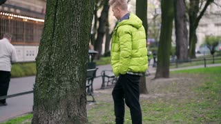 Pensive boy walking in the park and thinking