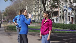 People drinking water after jogging, slow motion shot at 120fps, steadycam shot