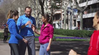 People drinking water after jogging, slow motion shot at 240fps, steadycam shot