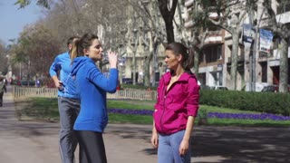 People drinking water after jogging, slow motion shot at 60fps, steadycam shot