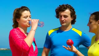 People drinking water and smiling during break, steadycam shot, slow motion shot