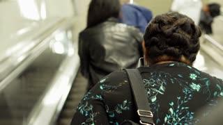 People on escalator on the station, steadycam shot