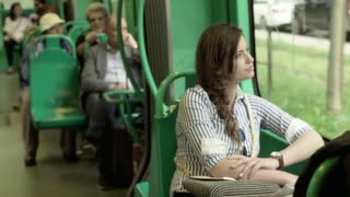 People traveling by bus in the city, steadycam shot