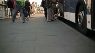 People waiting for the bus and embus on the station