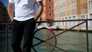 Portrait of serious looking rich manstandind in Venice