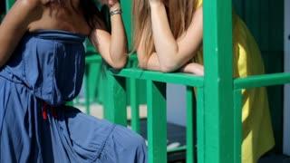Portrait of talking female friends, outdoors, steadycam shot