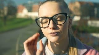 Pretty girl taking off glasses and havin headache, steadycam shot