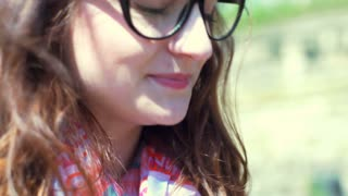 Pretty girl wearing glasses and looking very happy, steadycam shot
