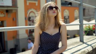 Pretty girl wearing sunglasses and looking very happy, steadycam shot