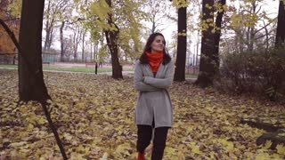 Relaxed woman walking in the park, steadycam shot, slow motion shot at 240fps