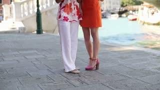 Rich female friends talking on cellphone in Venice