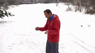 Runner with instructor while training in a wintry wood
