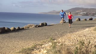 Runners while training on seashore, slow motion shot at 240fps