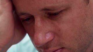 Sad man close up, slow motion shot at 240fps