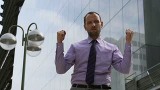 Serious businessman looking to camera, slow motion shot, steadycam shot