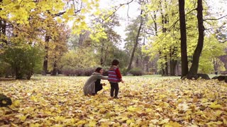 Son and mother playing in the park, steadycam shot, slow motion shot at 240fps