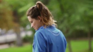 Sporty women chatting in the park, slow motion shot, steadycam shot