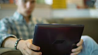 Student holding tablet and browsing internet on it