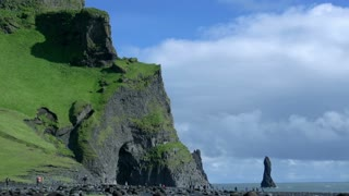 Time lapse Reynisdrangar cliffs at south coast of Iceland at daytime