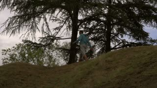 Tired jogger walking on the hill, slow motion shot at 240fps, steadycam shot
