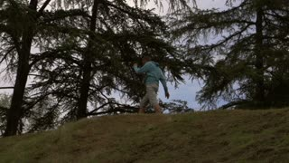 Tired jogger walking on the hill, slow motion shot, steadycam shot