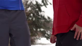 Two runners while training in a wintry wood
