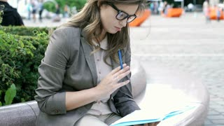 Attractive businesswoman thinking while working on documents, steadycam shot