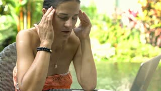 Attractive woman looks dissatisfied while having painful headache, steadycam sho