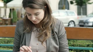 Attractive woman receives good news and texting back on smartphonem steadycam sh