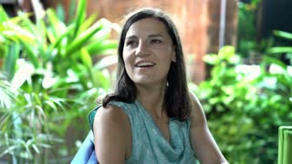Attractive woman relaxing in exotic place and smiling to the camera, steadycam s
