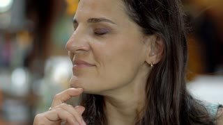 Attractive woman relaxing in restaurant, close up, steadycam shot