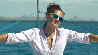 Attractive woman relaxing on the yacht on windy day, steadycam shot