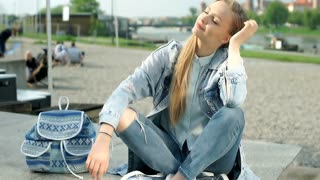 Beautiful girl enjoying weather and smiling to the camera, steadycam shot