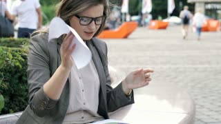 Businesswoman looks angry while checking documents and destroying them, steadyca